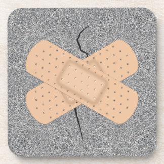 Bandage On A Crack Beverage Coasters
