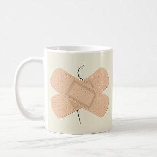 Bandage On A Crack Coffee Mugs