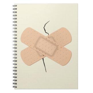 Bandage On A Crack Spiral Notebook