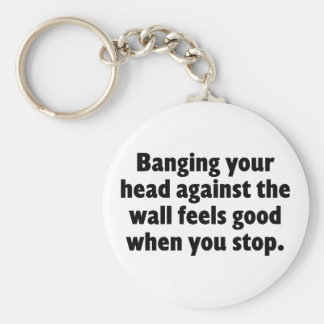 Banging your head against a brick wall key chains