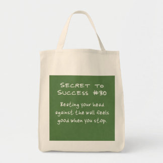 Banging your head against the wall grocery tote bag