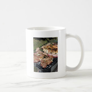 Barbecued steak and sausages on the grill coffee mug