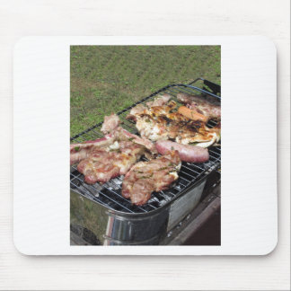 Barbecued steak and sausages on the grill mouse pad