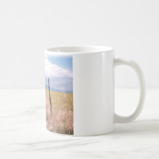 Barbed wire and post. coffee mug