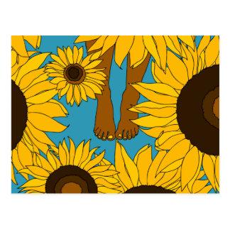 Bare feet in sunflower field postcard