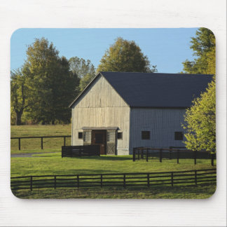 Barn on thoroughbred horse farm at sunrise, mouse mat