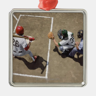 Baseball batter awaiting pitch with catcher and christmas ornament