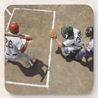 Baseball batter awaiting pitch with catcher and coaster