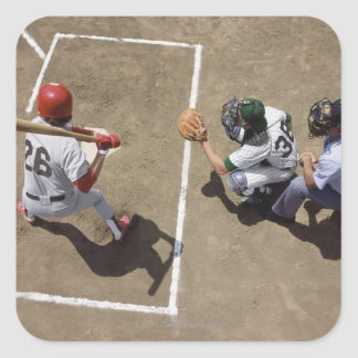 Baseball batter awaiting pitch with catcher and square sticker