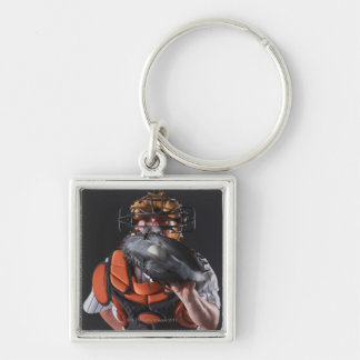 Baseball catcher holding ball in mitt key ring