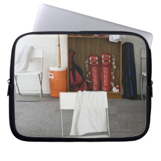 Baseball equipment in locker room laptop sleeve