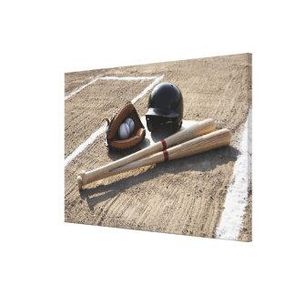 Baseball glove, balls, bats and baseball helmet canvas print