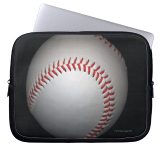 Baseball on black background, close-up laptop sleeve