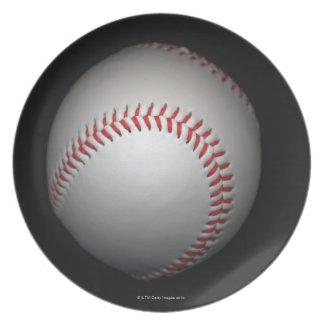 Baseball on black background, close-up plate