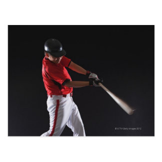 Baseball player about to hit the ball postcard