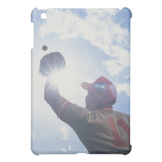 Baseball player catching ball with sun in his iPad mini cases