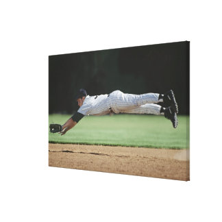 Baseball player in mid-air catching ball. canvas print