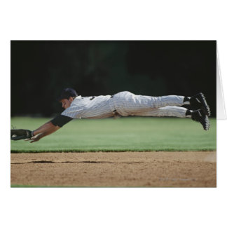 Baseball player in mid-air catching ball. card