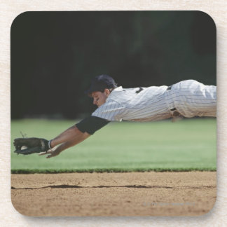 Baseball player in mid-air catching ball beverage coaster