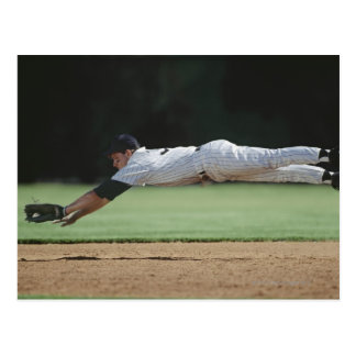 Baseball player in mid-air catching ball. postcard