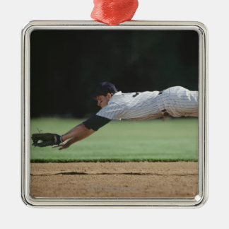 Baseball player in mid-air catching ball. Silver-Colored square decoration