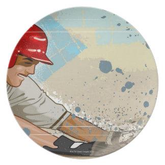 Baseball player sliding into base dinner plates