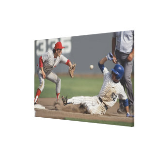 Baseball player sliding into third base with canvas print