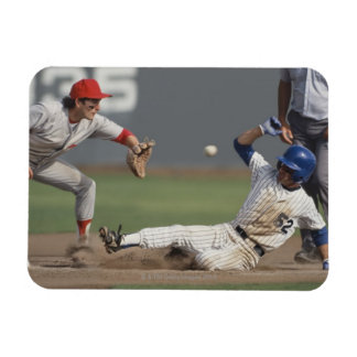 Baseball player sliding into third base with magnet