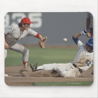 Baseball player sliding into third base with mouse pad
