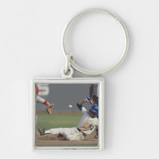 Baseball player sliding into third base with Silver-Colored square key ring