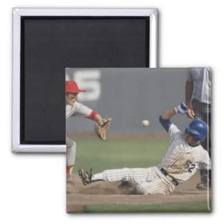 Baseball player sliding into third base with square magnet
