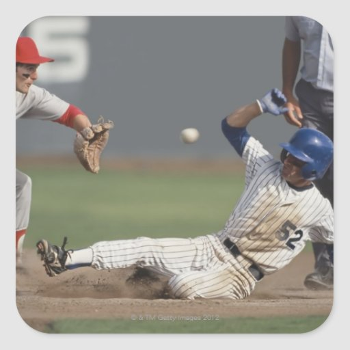 Baseball player sliding into third base with sticker