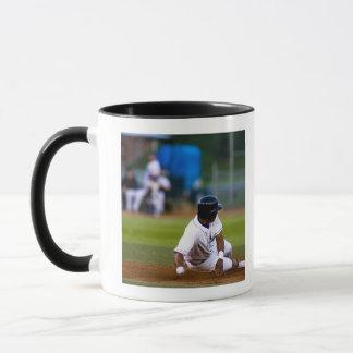 Baseball player sliding onto a base mug