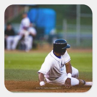 Baseball player sliding onto a base square sticker
