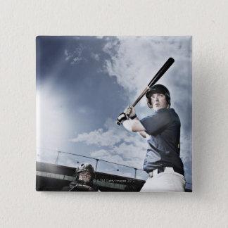 Baseball player swinging baseball bat 15 cm square badge