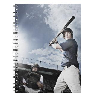 Baseball player swinging baseball bat notebooks