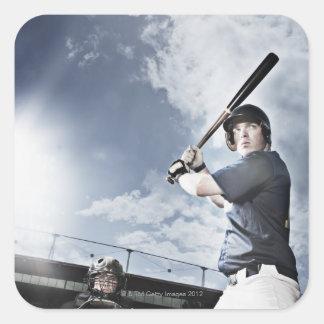 Baseball player swinging baseball bat square sticker