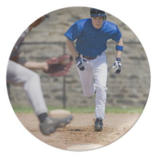 Baseball player trying to steal base plate