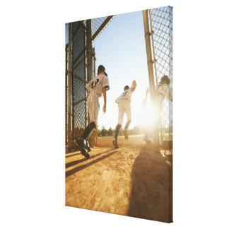Baseball players (10-11) entering baseball canvas print