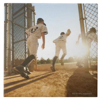 Baseball players (10-11) entering baseball tile