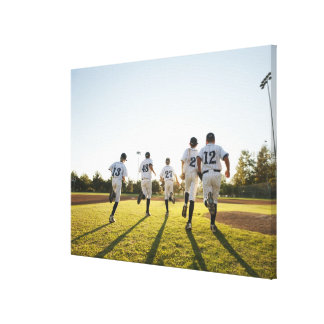Baseball players (10-11) running on baseball canvas print