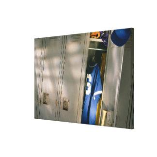 Baseball uniform and equipment in locker canvas print