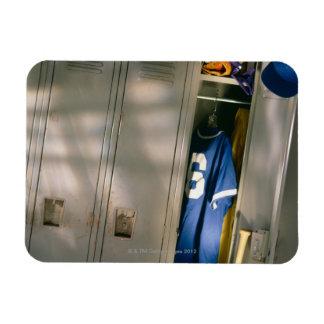 Baseball uniform and equipment in locker rectangular photo magnet