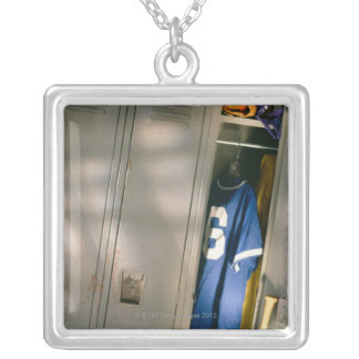 Baseball uniform and equipment in locker silver plated necklace