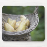 Basket of freshly picked pears. mouse mat