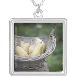 Basket of freshly picked pears silver plated necklace
