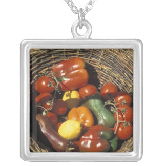 Basket of fruits and vegetables on the place silver plated necklace