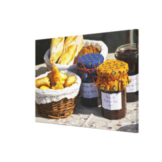 Basket with croissants and chocolate breads gallery wrapped canvas