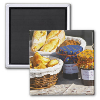 Basket with croissants and chocolate breads. square magnet
