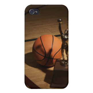 Basketball and trophy on basketball court, cover for iPhone 4